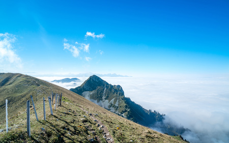 sea of fog from top of the mountain hiking switzerland