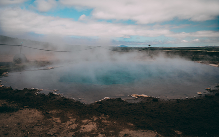 geysir hot very blue water spring with steam in iceland