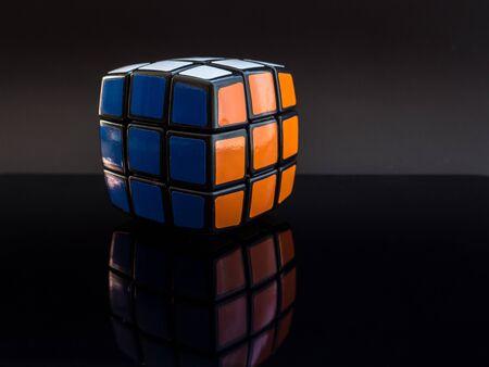 round rubik's cube on black background with reflection studio light Editoriali