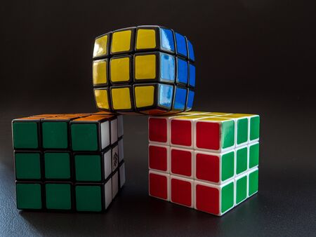 different types of rubik's cube white black and round on black background studio light Editoriali