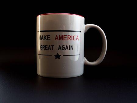 make america great again cup in studio light trump campaign white coffee cup Archivio Fotografico - 140783409