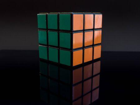 rubik's cube on black background with reflection solved studio light Editoriali