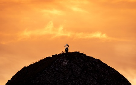 people on mountain summit peak with cross during sunset golden silhouette dramatic sunset brienzer rothorn switzerland