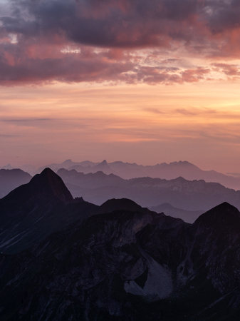 dramatic sunset over mountain range in the swiss alps brienzer rothorn switzerland Archivio Fotografico