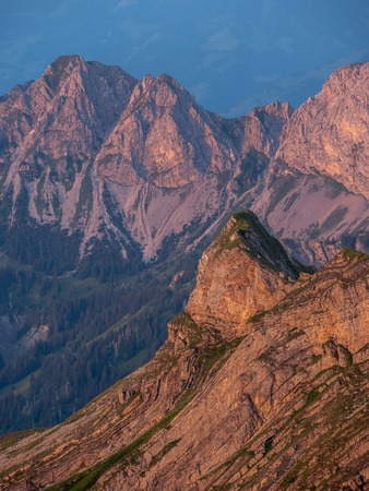 mountain peak during sunset in golden hour the swiss alps, brienzer rothorn vertical Archivio Fotografico