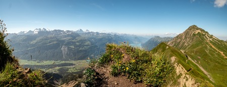 panoramic view over the swiss alps from the peak of a mountain, brienzer rothorn hohenweg