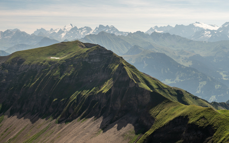 beautiful mountain scenery in the swiss alps with cross on the mountain peak brienzer rothorn