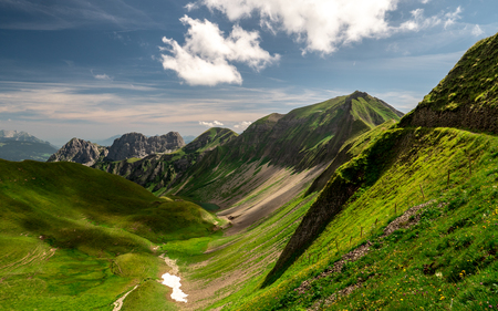 scenic mountain view during summer sunny day in the swiss alps, ridge walk brienzer rothorn hohenweg