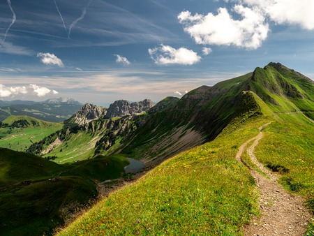 scary hiking path with beautiful scenery view over the swiss alps and mountain lake brienzer rothorn switzerland