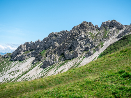 steep mountain cliffs during summer sunny day in the swiss alps sorenberg Archivio Fotografico