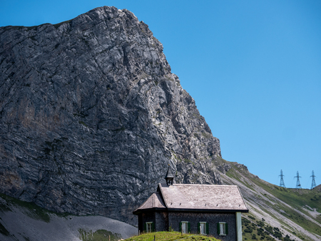 little christian church or chapel isolated in mountain scenery, switzerland alps sorenberg