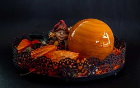 halloween autumn decoration with cute little dwarf orange colors on black background fall