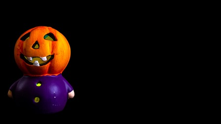 halloween decoration little pumpkin head rgb lighted with black background space for text Archivio Fotografico
