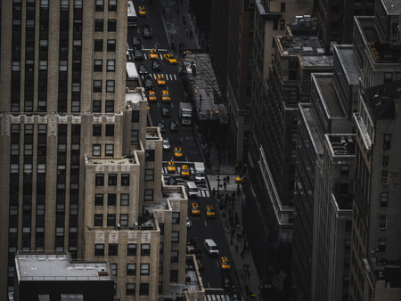 new york architecture streets from above with yellow taxi in focus low saturation