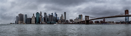New York City downtown skyline during cloudy rainy day, skyscrapper covered in clouds USA 免版税图像