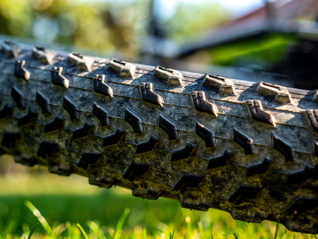 close up of dirty mountain bike wheel profile with dirt and natrual background