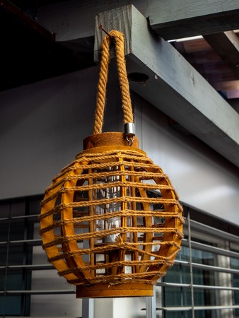 cool outdoor lamp hanging from the roof wood