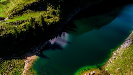 trees with shadow on deep blue mountain lake aerial view switzerland alpstein Archivio Fotografico - 120999293