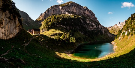 panoramic view over deep blue mountain lake in swiss alps with house, switzerland alpstein Archivio Fotografico - 120999294