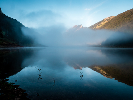 fog covered mountain lake during sunrise morning switzerland alpstein