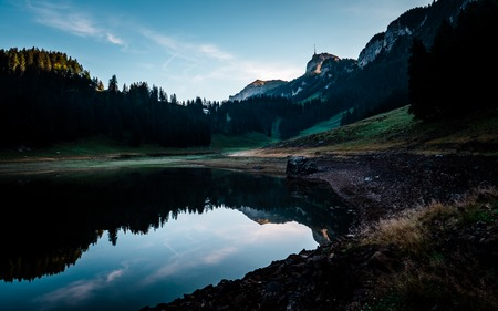amazing water reflection in clear moutain lake during sunrise morning switzerland alpstein