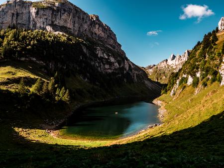deep blue mountain lake in swiss alps, switzerland alpstein