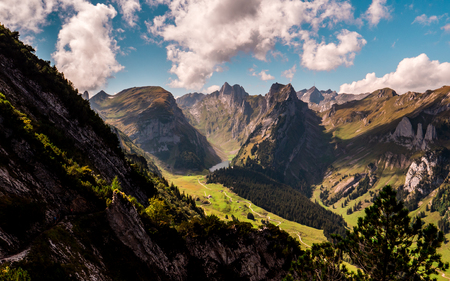 typical swiss mountain scenery with mountain lake during sunny summer day alpstein Archivio Fotografico