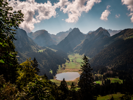 typical swiss mountain scenery with mountain lake during sunny summer day alpstein Archivio Fotografico - 120999312