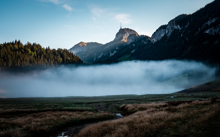 fog covered mountain lake during sunrise morning switzerland alpstein Archivio Fotografico - 120999319
