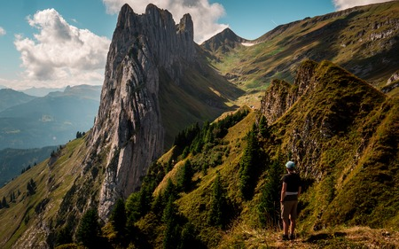 crazy rock formation in the swiss mountains alpstein, guy standing on top of a mountain Archivio Fotografico - 120999323