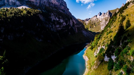 aerial view of deep blue mountain lake in swiss alps with house, switzerland alpstein Archivio Fotografico - 120999326