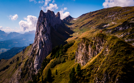 crazy rock formation in the swiss mountains alpstein, guy standing on top of a mountain Archivio Fotografico - 120999327