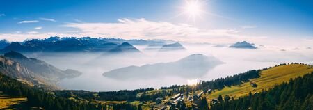 panoramic drone view over snow covered mountains during autumn, aerial view over swiss alps with lake in fog covered, rigi switzerland sunny Archivio Fotografico - 131919892