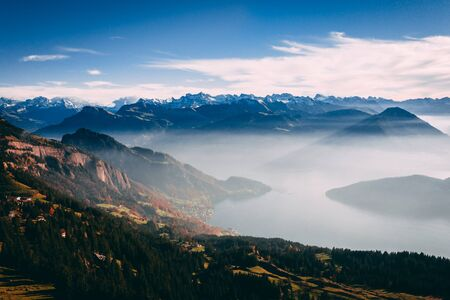 aerial view of mountain scenery in the swiss alps during late autumn, colored pinetrees and blue Lake Lucerne seen from rigi switzerland sunny Archivio Fotografico - 131919687