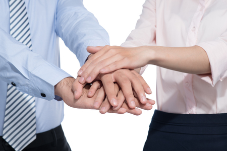 Two people standing with their hands on top each other and smiling isolated Imagens