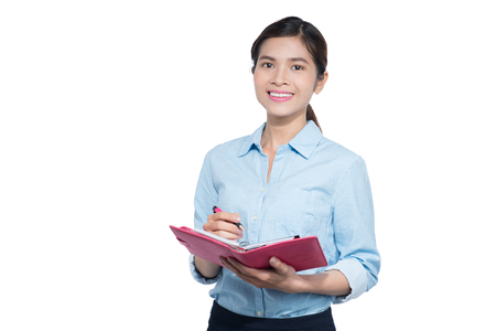 executive assistants: Vietnamese Businesswoman take note on notebook Stock Photo