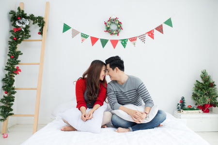 Christmas. Asian Couple at home celebrating New Year.