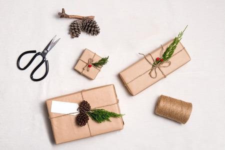tied in: Christmas presents. Packages wrapped in kraft paper tied with jute and  label to copy space Stock Photo