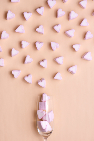 Valentines Day Glass with lots of candy hearts marshmallows Stock Photo