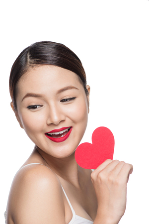 retro woman: Cute attractive young woman with red heart. Valentines day art portrait. Perfect make up Stock Photo