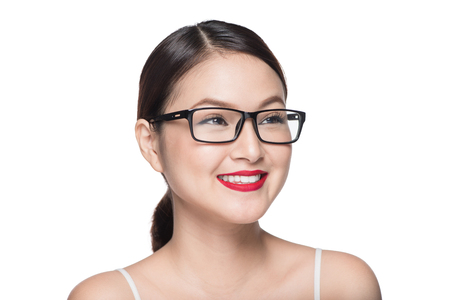 Beauty asian model girl with perfect skin wearing glasses, isolated on white background.