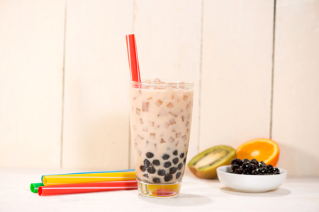 Boba  Bubble tea. Homemade Milk Tea with Pearls on wooden table. Stock Photo