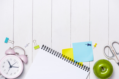 stuff: School stationery or office supplies on wood background.