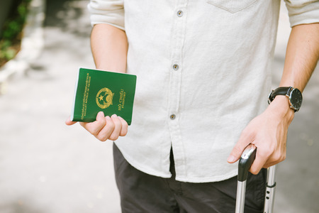 Man hands holding Vietnamese Passport. Ready for traveling.