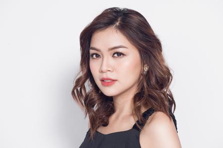 Beautiful stylish asian woman in elegant casual black outfit posing