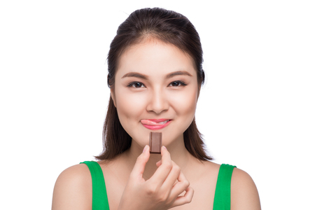 Portrait of a young asian woman holding a chocolate bar to enjoy the taste Stock Photo