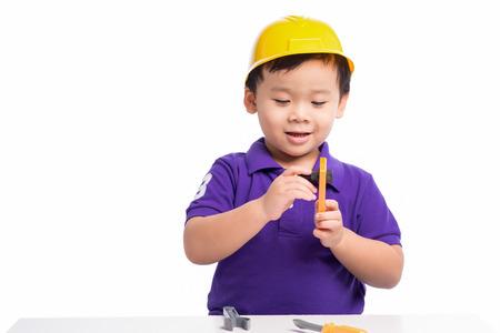 Little repairman in hardhat with repair tools