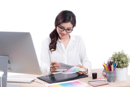 Graphic designer at work. Asian woman sitting on desk.