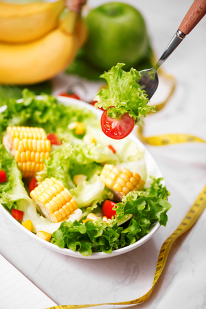 Healthy fitness meal with fresh salad. Banco de Imagens