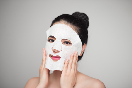 paper sheet: Spa, healthcare. Asian girl with a cosmetic mask. Stock Photo